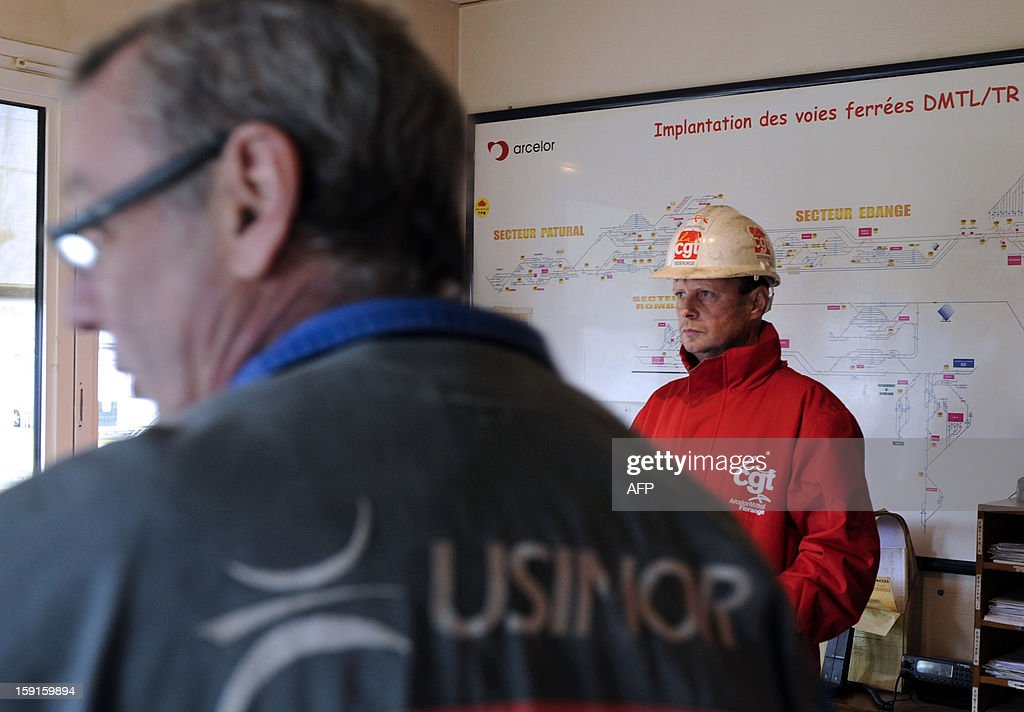ArcelorMittal employees from Florange plant, eastern France, are pictured on January 9, 2013 in the railway station of the nearby Ebange station, the only train route to the plant, where they block the traffic during a protest. ArcelorMittal, run by steel tycoon Lakshmi Mittal, had said it will shut down two furnaces at Florange that are no longer used if a buyer for them cannot be found. AFP PHOTO JEAN-CHRISTOPHE VERHAEGEN