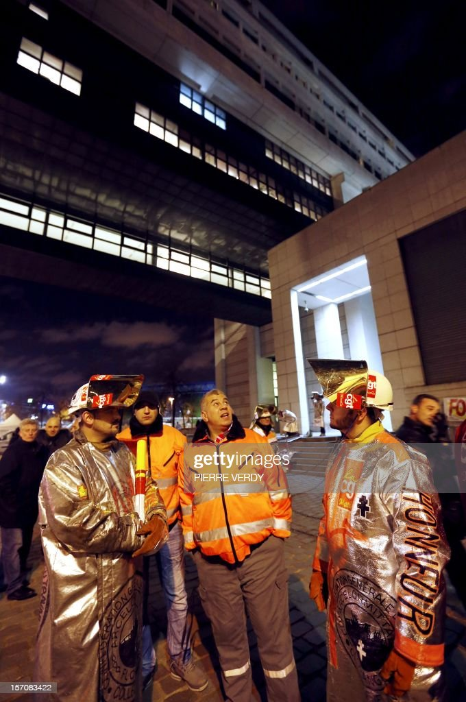 Arcelor-Mittal employees gather in front of the Enonomy ministry as the group's unionists meet French Minister for Industrial Renewal on November 28, 2012. France said today it had an investor willing to invest 400 million euros ($515 million) in a steel plant at the centre of a bitter row between the government and its owner ArcelorMittal.