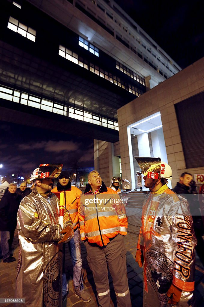 Arcelor-Mittal employees gather in front of the ministry as the group's unionists meet French Minister for Industrial Renewal on November 28, 2012. France said today it had an investor willing to invest 400 million euros ($515 million) in a steel plant at the centre of a bitter row between the government and its owner ArcelorMittal.