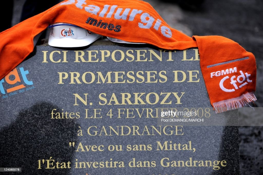 ArcelorMittal ' Here we can read Sarkozy's promises ' and light a candle to mark the visit of the French President Nicolas Sarkozy one year after...
