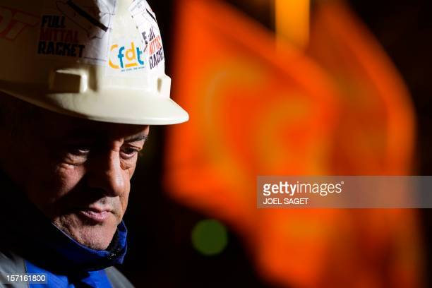 ArcelorMittal steel plant employees gather at their makeshift campsite outside the economy ministry in Paris on November 29 2012 The head of France's...