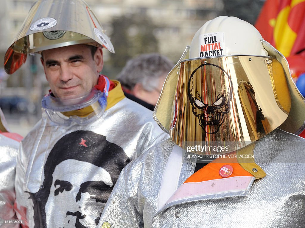 ArcelorMittal workers wearing steelmaker helmets and clothes take part in a demonstration called by French CGT trade union on February 13, 2013 in Metz, eastern France, to claim for the safeguard of the local industry in the French eastern region of Lorraine.
