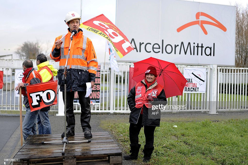 ArcelorMittal's workers block the entrance of the ArcelorMittal Basse-Indre plant on December 10, 2012 in Indre, western France, to protest against the transfer of a part of their activity to the group's plant in Florange. AFP PHOTO JEAN-SEBASTIEN EVRARD
