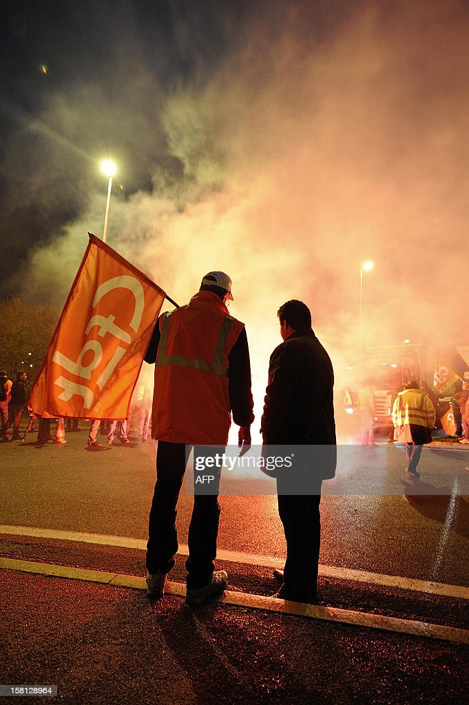 ArcelorMittal's workers block the entrance of the ArcelorMittal Basse-Indre plant on December 10, 2012 in Indre, western France, to protest against the transfer of a part of their activity to the group's plant in Florange.