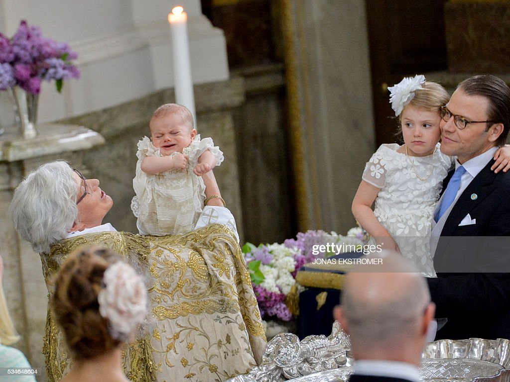 Arch Bishop Antje Jackela holds Prince Oscar while Princess Estelle and Prince Daniel look on at the christening on May 27, 2016 at the Chapel in Stockholm's Royal palace. News Agency / Jonas EKSTROMER / Sweden OUT