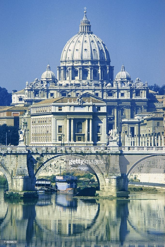Arch Bridge Across A River In Front Of A Basilica St