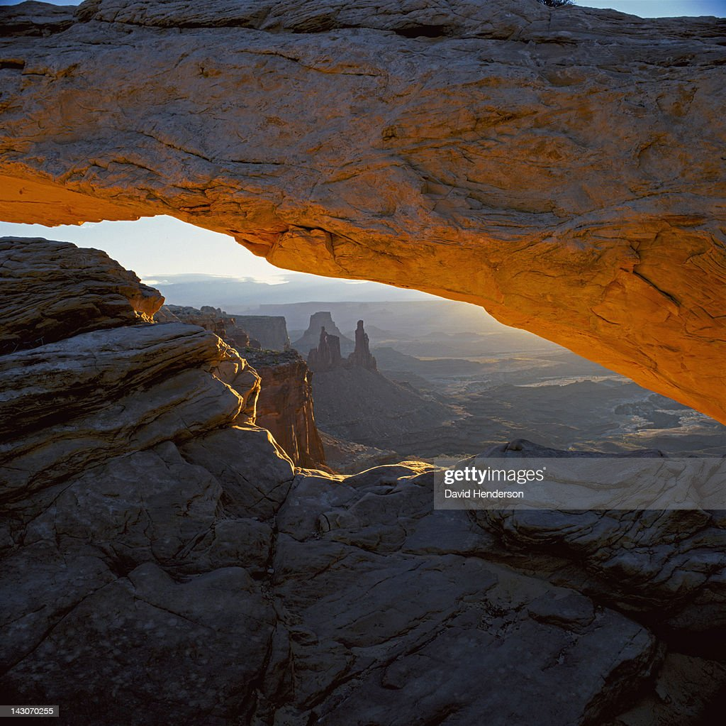 Arch in desert landscape