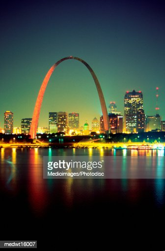 Arch over the Mississippi River at night in St. Louis, USA