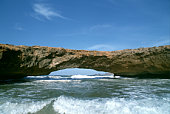 Arch rock formation in sea , Aruba