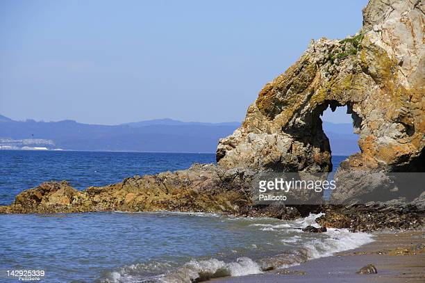 Arch Rock formation in sea