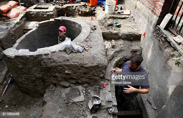 Archaeologist and volunteer Elizabeth Neill left works in the cistern while City archaeologist Joe Bagley works in the privy/outhouse Crews are...