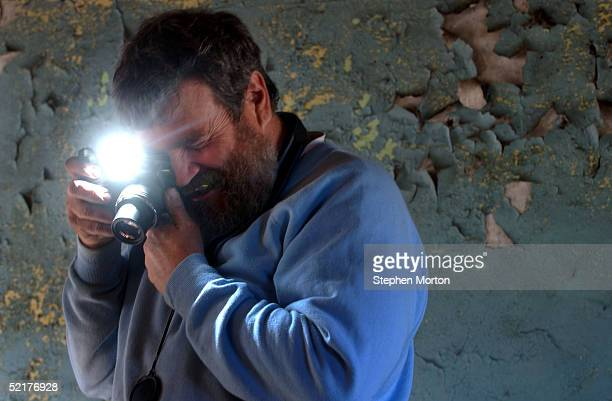 Archaeologist Dan Elliot President of the Lamar Institute takes a photo in the main room of a tabby slave ruin February 10 2005 on Ossabaw Island...