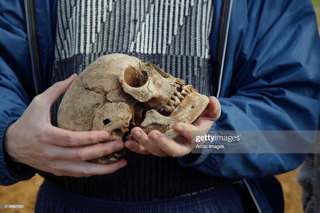 Archaeologist Holding Viking Era Skull