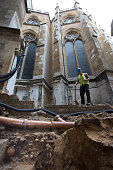 Archaeologist Paw Jorgensen stands above a collection of bones that were found among the stepped footings of Westminster Abbey's south transept on...