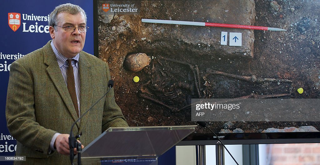Archaeologist Richard Buckley addresses a press conference at Leicester University in central england, on February 4, 2013, in front of a picture of King Richard III's open burial site. A skeleton found under a car park in the English city of Leicester is that of King Richard III, widely regarded as one of history's most notorious villains, scientists confirmed Monday.