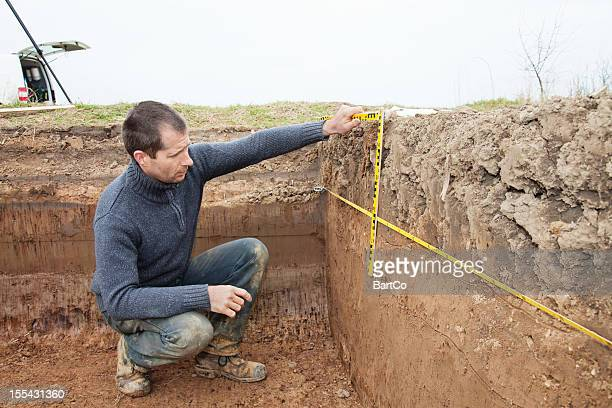 Archaeologist Using Foot Measure