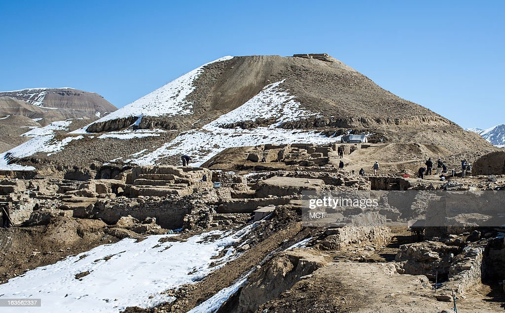 Archaeologists and local laborers excavate the main part of the ancient city at Mes Aynak in Afghanistan, which sits on the old Silk Road trading route connecting China and India with the Mediterranean.