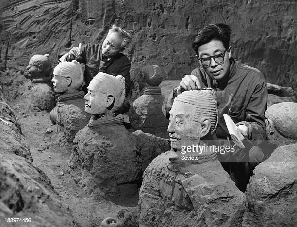 Archaeologists excavating terracotta warriors and horses at the tomb of the first emperor of China Qin Shi Huang Ti in Xian China September 1979