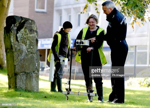 Archaeologists Maureen Kilpatrick using a Resistance Meter and Beth Spence using a Gradiometer with Central Scotland Police Deputy Chief Constable...