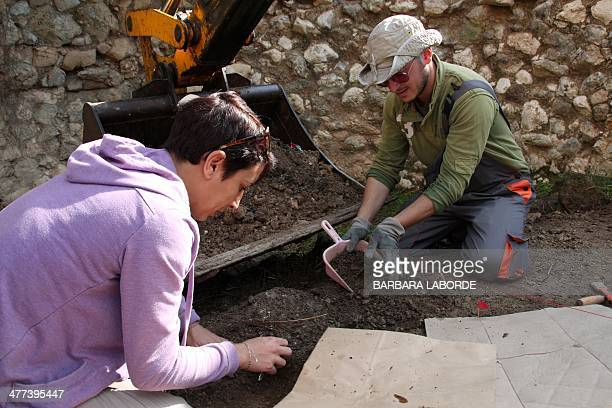 PERROT Archaeologists of the Committee on Missing Persons Turkish Cypriot Hazar Kaba and Greek Cypriot Christiana Zenonos work to unearth remains at...