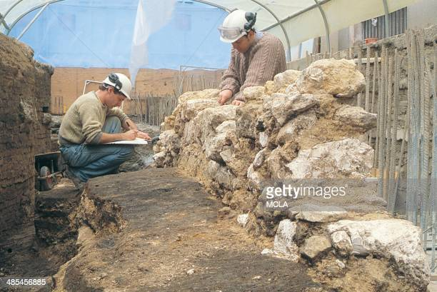 Archaeologists recording one of the internal walls of Blackwell Hall from the 19929 excavations at the Guildhall City of London