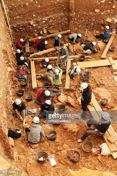 Archaeologists take part in the beginning of an excavation at the Gran Dolina site part of the archaeological site of Atapuerca in the Sierra de...