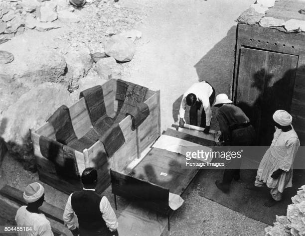 Archaeologists working at the Tomb of Tutankhamun Valley of the Kings Egypt 1922 Moving the centre portion of one of the beds or couches from the...
