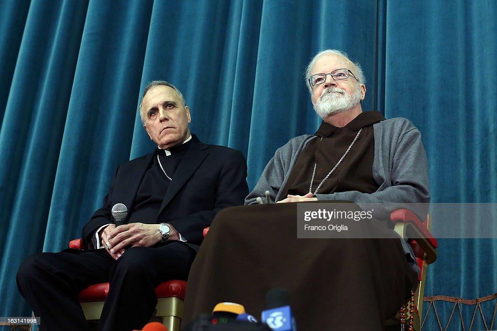 Archbischop of Galveston-Houston cardinal Daniel Di Nardo (L) and Franciscan archbischop of Boston cardinal Sean O'Malley (R) attend a meeting with accreditated media at Vatican at the Pontifical North American College on March 5, 2013 in Vatican City, Vatican.