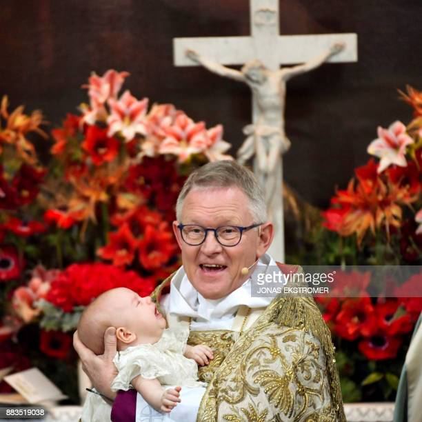 Archbishop Anders Wejryd holds prince Gabriel during the baby Prince's christening in Drottningholm Palace Chapel outside Stockholm 1 December 2017...