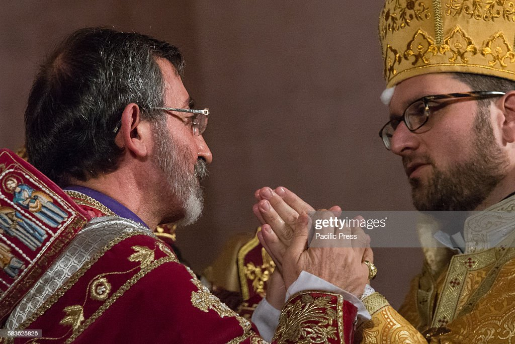 Archbishop Barsamian clasps the hands of Father Avedis Archbishop Khajag Barsamian Prelate of the Eastern Diocese of the Armenian Apostolic Church of...