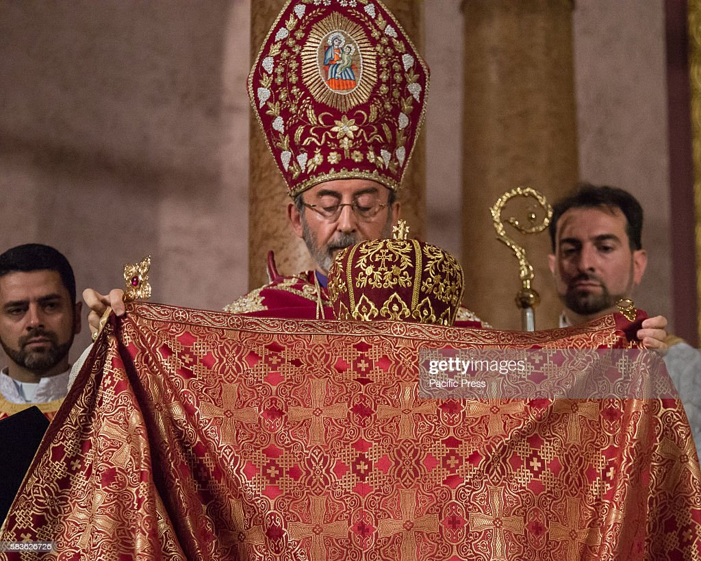 Archbishop Barsamian invests Father Armash with a robe Archbishop Khajag Barsamian Prelate of the Eastern Diocese of the Armenian Apostolic Church of...
