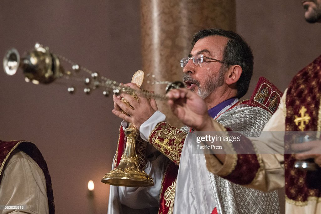 Archbishop Barsamian raises the Eucharistic chalice and host as a deacon swings a censer Archbishop Khajag Barsamian Prelate of the Eastern Diocese...