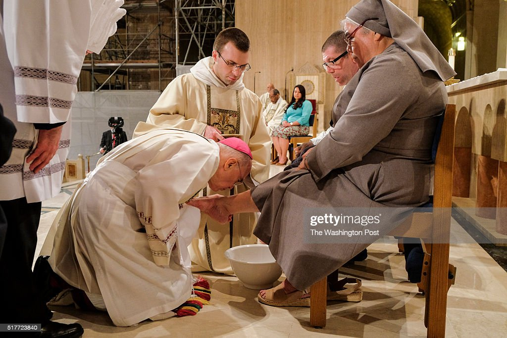 Archbishop Carlo Maria Vigano, the Vatican's ambassador to the US, finishes washing the foot of Sister Antonia Sanchez, 65, at the Basilica of the National Shrine of the Immaculate Conception on Thursday, March 24, 2016, in Washington, DC. This day marked the first time the Basilica has included women in the annual foot washing ceremony done on Maundy Thursday, during Holy Week. While practices have varied and many parishes in the West have long included women, Pope Francis officially said for the first time in January that women's feet could be washed.