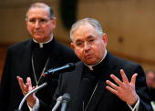 Archbishop Jose Gomez of San Antonio Texas speaks during a news conference as Cardinal Roger Mahony listens at cathedral of Our lady of the Angeles...