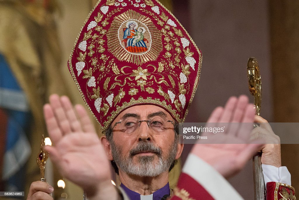 Archbishop Khajag is seen between the upraised hands of the two deacons being ordained Archbishop Khajag Barsamian Prelate of the Eastern Diocese of...
