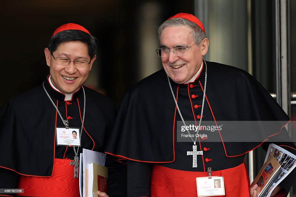 Archbishop of Barcelona cardinal Lluis Martinez Sistach and Manila Archbishop cardinal Luis Antonio Tagle leave the Synod Hall at the end of a...