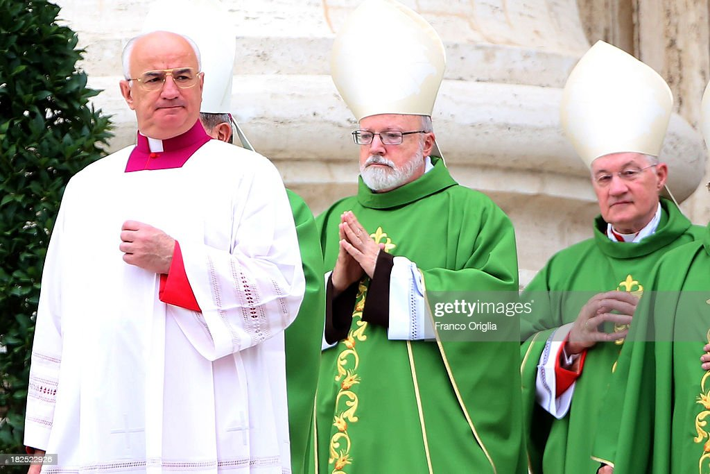 Archbishop of Boston Cardinal Sean O'Malley (C) and Canadian cardinal <a gi-track='captionPersonalityLinkClicked' href=/galleries/search?phrase=Marc+Ouellet&family=editorial&specificpeople=3145328 ng-click='$event.stopPropagation()'>Marc Ouellet</a> (R) attend a mass held by Pope Francis in St. Peter's square on the occasion of the Day for Catechists on September 29, 2013 in Vatican City, Vatican. Pope Francis celebrated Mass to mark the International Day for Catechists in the context of the Year of Faith. The dangers of complacency and the need for catechists to have the core and essence of the Gospel at the centre of their lives and work were the themes of the Holy Father's remarks.