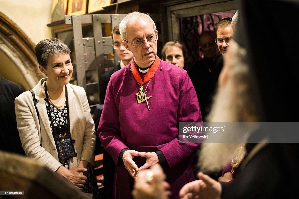 Archbishop of Canterbury <a gi-track='captionPersonalityLinkClicked' href=/galleries/search?phrase=Justin+Welby&family=editorial&specificpeople=9960447 ng-click='$event.stopPropagation()'>Justin Welby</a> (C) and his wife Caroline receive an explanation about the Orthodox Church of Jerusalem from Patriarch Theophilos III during their visit to the church of the Holy Sepulchre on June 28, 2013 in Jerusalem's Old City, Israel. The Most Reverend <a gi-track='captionPersonalityLinkClicked' href=/galleries/search?phrase=Justin+Welby&family=editorial&specificpeople=9960447 ng-click='$event.stopPropagation()'>Justin Welby</a> is on a five-day tour of Egypt and the Holy Land to visit a number of leaders and famous sites.
