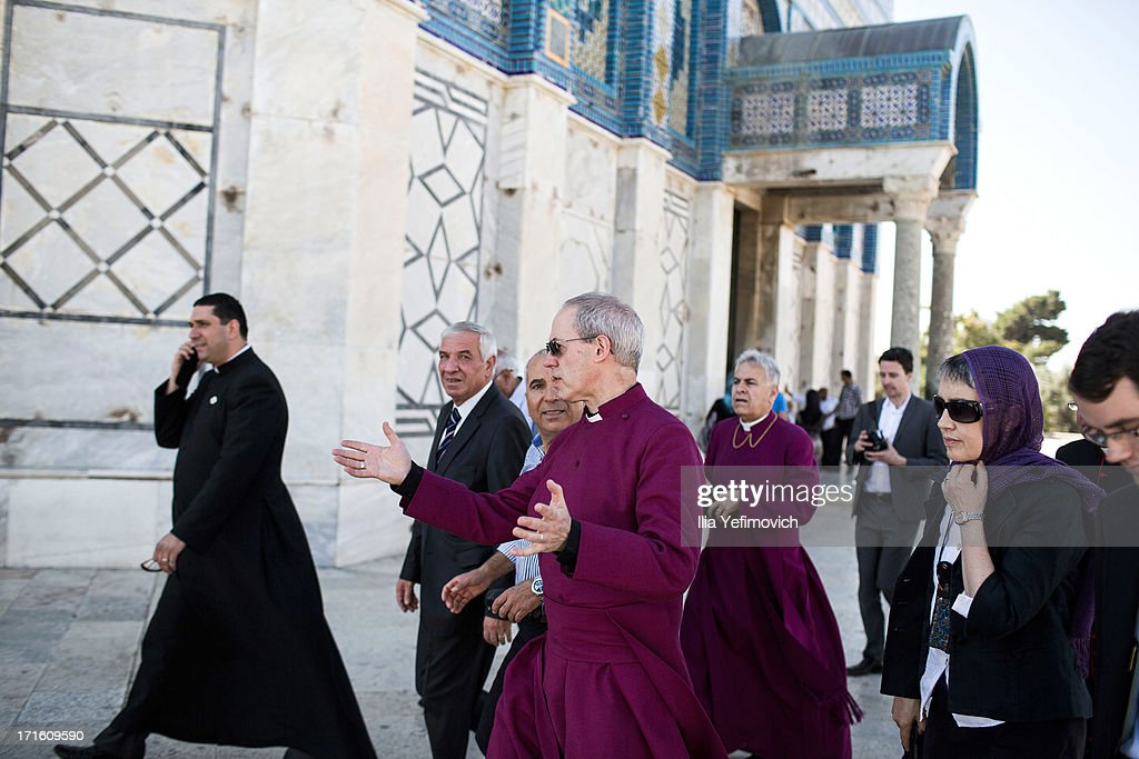 Archbishop of Canterbury <a gi-track='captionPersonalityLinkClicked' href=/galleries/search?phrase=Justin+Welby&family=editorial&specificpeople=9960447 ng-click='$event.stopPropagation()'>Justin Welby</a> (C) and wife Caroline (R) visit the holy Muslim site the Al-Aqsa compound on June 27, 2013 in Jerusalem's old city, Israel. The Most Reverend <a gi-track='captionPersonalityLinkClicked' href=/galleries/search?phrase=Justin+Welby&family=editorial&specificpeople=9960447 ng-click='$event.stopPropagation()'>Justin Welby</a> is on a five-day tour of Egypt and the Holy Land to visit a number of leaders and famous sites.