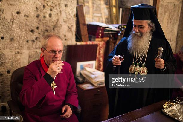Archbishop of Canterbury Justin Welby drinks with Patriarch Theophilos III of the Orthodox Church of Jerusalem during his visit to the church of the...