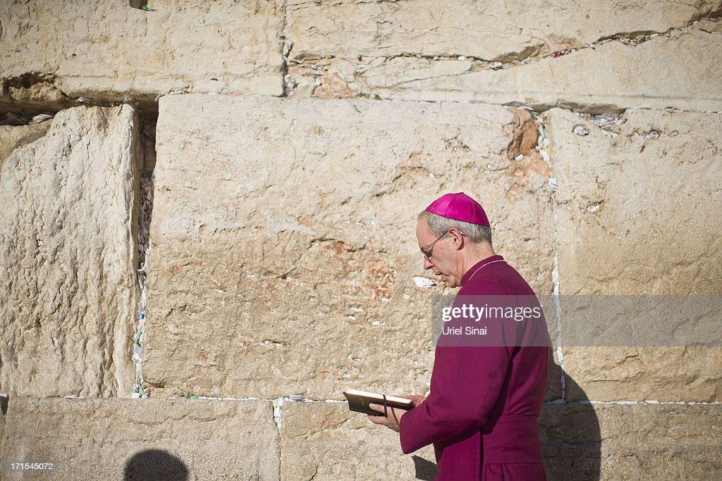 Archbishop of Canterbury <a gi-track='captionPersonalityLinkClicked' href=/galleries/search?phrase=Justin+Welby&family=editorial&specificpeople=9960447 ng-click='$event.stopPropagation()'>Justin Welby</a> prays at the Western wall on June 26, 2013 in Jerusalem's old city, Israel. The Most Reverend <a gi-track='captionPersonalityLinkClicked' href=/galleries/search?phrase=Justin+Welby&family=editorial&specificpeople=9960447 ng-click='$event.stopPropagation()'>Justin Welby</a> is on a five-day tour of Egypt and the Holy Land to visit a number of leaders and famous sites.