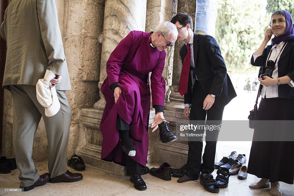 Archbishop of Canterbury Justin Welby takes off his shoes off before entering the mosque during his visit to the holy Muslim site the Al-Aqsa compound on June 27, 2013 in Jerusalem's old city, Israel. The Most Reverend Justin Welby is on a five-day tour of Egypt and the Holy Land to visit a number of leaders and famous sites.