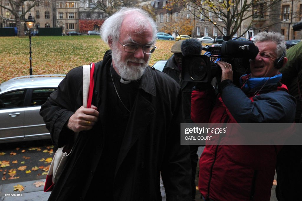 Archbishop of Canterbury Rowan Williams arrives at the venue of the three-day Church of England General Synod in central London on November 20, 2012, during which there will be a vote on whether to allow women to become bishops. The 470-member General Synod will vote on November 20 on the issue of women bishops which has split traditionalists and liberals, two decades after England's established state Church backed the introduction of women priests. AFP PHOTO / CARL COURT