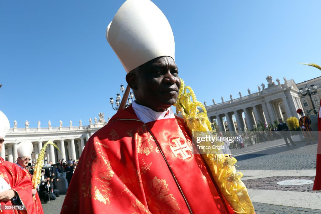 Archbishop of Cape Coast, Cardinal Peter Appiah Turkson attends Palm Sunday Mass celebrated by Pope Francis at St. Peter's Square on April 9, 2017 in Vatican City, Vatican. At the end of the mass Pope Francis condemned the terror attack on a Coptic church dedicated to St. George ' Mar Girgis ' in the city of Tanta, north of Cairo, which killed at least 21 people and injured nearly 60 others.