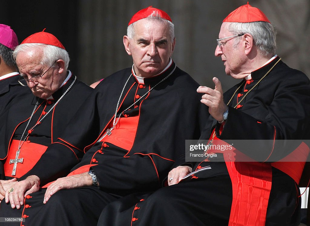 Archbishop of Cologne Cardinal Joachim Meisner (R) talks with Archbishop of St Andrews and Edinburgh Cardinal <a gi-track='captionPersonalityLinkClicked' href=/galleries/search?phrase=Keith+O%27Brien&family=editorial&specificpeople=4310729 ng-click='$event.stopPropagation()'>Keith O'Brien</a> (C) during the Pope Benedict XVI's weekly audience in St. Peter's Square on October 13, 2010 in Vatican City, Vatican. The Pontiff will name blessed sister Mary MacKillop's known also as Mary of the Cross as Australian first Saint in a Canonisation ceremony in St. Peter's square on next Sunday.