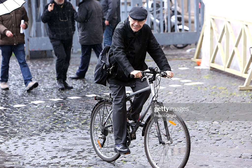 Archbishop of Lione cardinal Philippe Barbarin leaves the Paul VI Hall riding a bike at the end of the seventh general congregation on March 8, 2013 in Vatican City, Vatican. During the briefing at the Holy See press room following the seventh general congregation, Vatican spokesman father Federico Lombardi said that during this session cardinals accepted Scottish cardinal Keith O'Briens's reasons for not attending the Vatican Conclave to elect a new Pope.