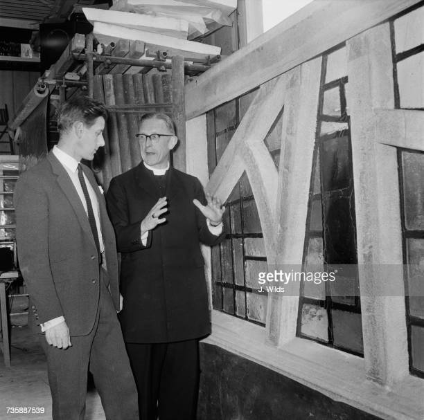 Archbishop of Liverpool George Beck visits the studio of stainedglass artist Patrick Reyntiens in Loudwater Buckinghamshire to view the stained glass...