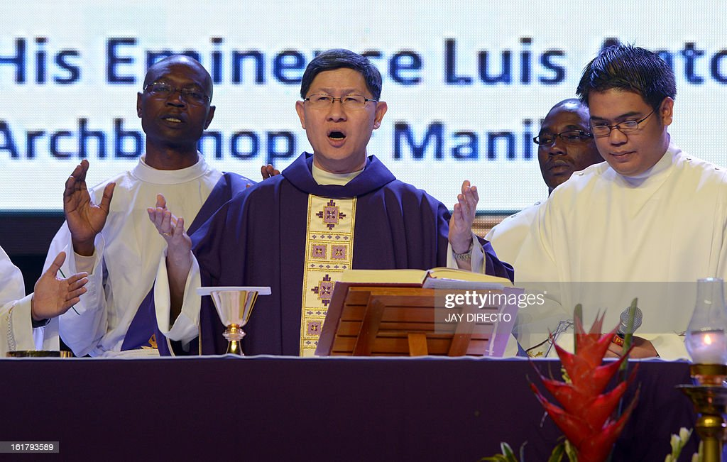 Archbishop of Manila Cardinal Luis Antonio Tagle (C) gives mass to the faithful at a Catholic gathering in Manila on February 16, 2013. Filipinos are hoping that 55-year-old Tagle, who was only made a cardinal last year, could become the next pope following the shock announcement by 85-year-old Pope Benedict XVI that he would resign because of health reasons. AFP PHOTO / Jay DIRECTO