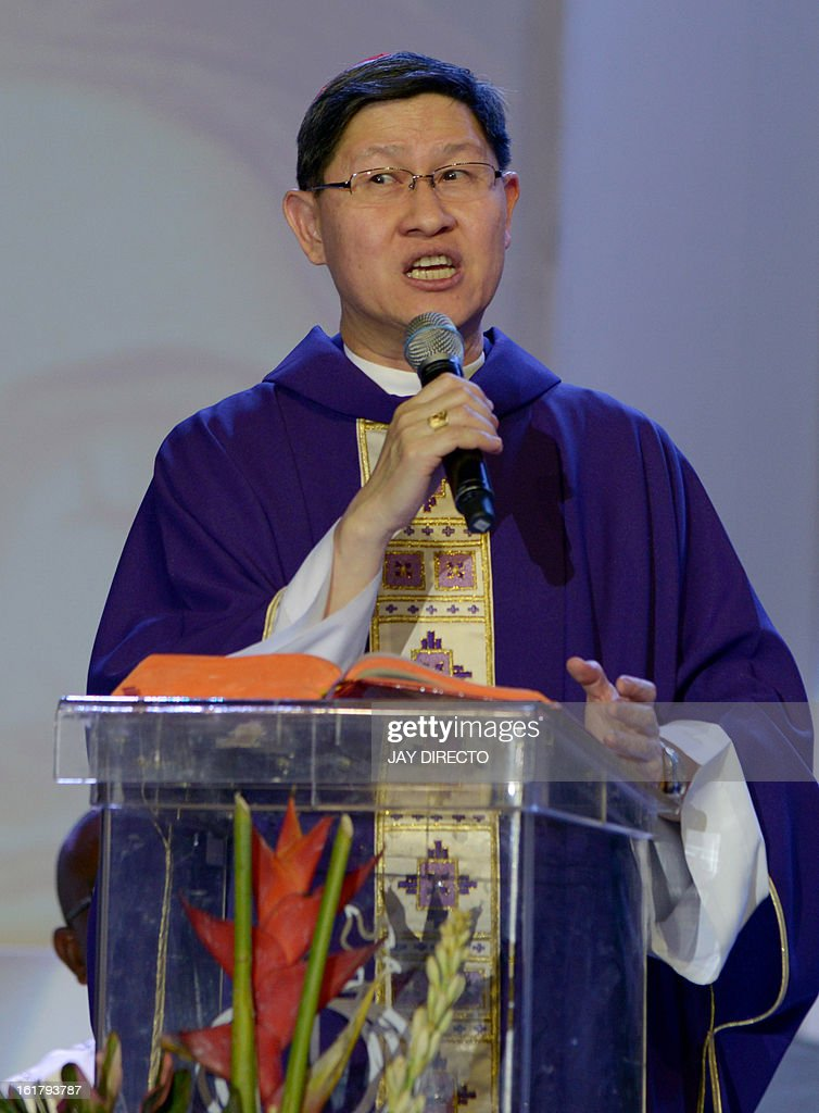 Archbishop of Manila Cardinal Luis Antonio Tagle gives mass to the faithful at a Catholic gathering in Manila on February 16, 2013. Filipinos are hoping that 55-year-old Tagle, who was only made a cardinal last year, could become the next pope following the shock announcement by 85-year-old Pope Benedict XVI that he would resign because of health reasons. AFP PHOTO / Jay DIRECTO