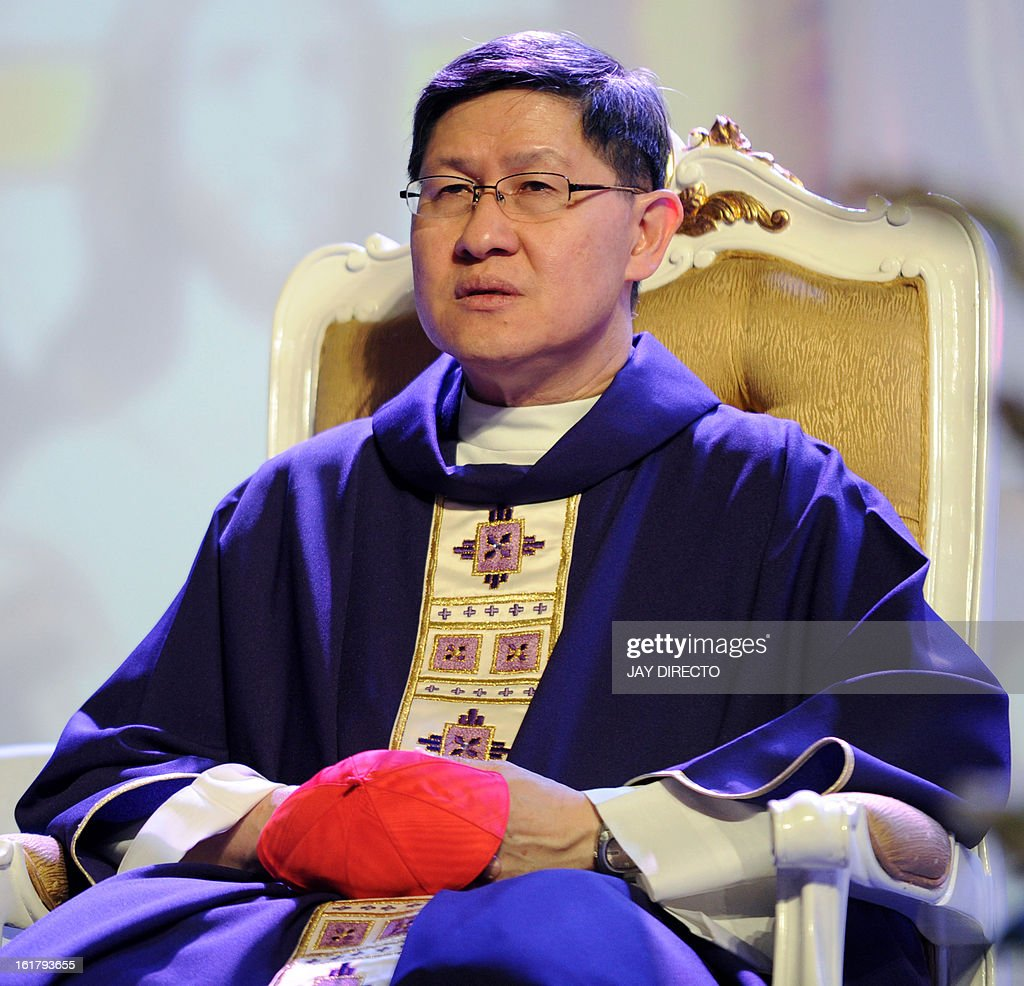 Archbishop of Manila Cardinal Luis Antonio Tagle sits during a mass at a Catholic gathering in Manila on February 16 2013 Filipinos are hoping that...